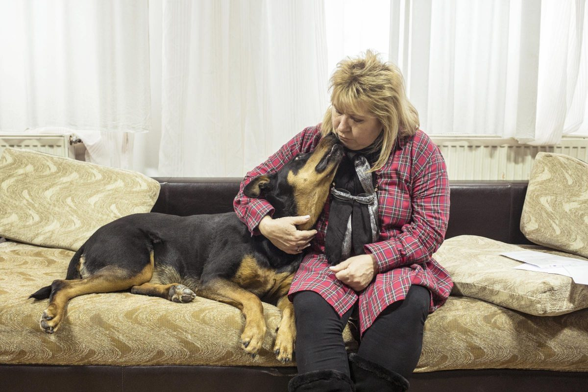 Iana Matei with one of her dogs in Reaching Out Romania's shelter in Pitești, Romania, on the 22nd of January 2019.